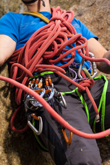 Climber holding red climbing rope