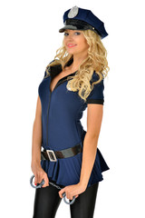 Beautiful blonde woman in mascarade costume of policeman.