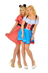 Two beautiful blonde women in carnival costumes of Mouse and Sno