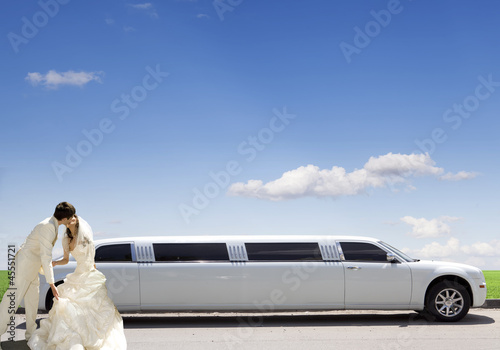 White car. wedding kiss