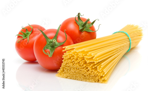 tomatoes and pasta on white background