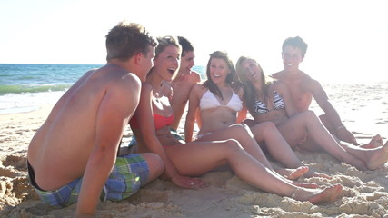 Group Of Teenage Friends Enjoying Beach Holiday