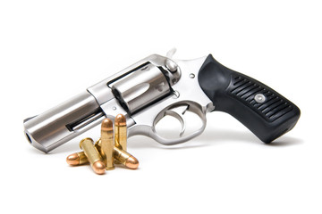 Silver Revolver With Bullets