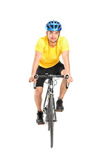 Full length portrait of a man with helmet riding a bycicle