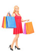 Full length portrait of a mature woman holding shopping bags