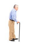 Full length portrait of a senior man walking with a cane
