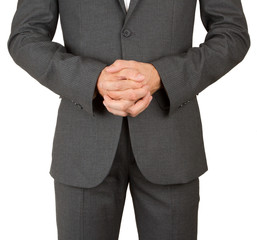 Business man in grey suit praying
