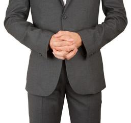 Business man in grey suit praying