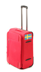 red suitcase with sticker with flag of Sweden isolated on white