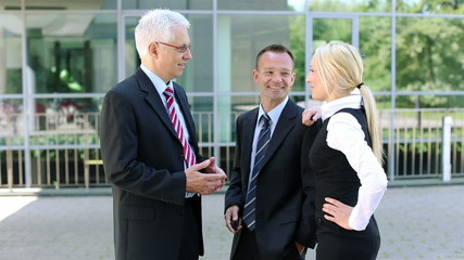 Business team talking in city