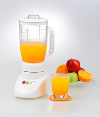 Fruits and orange juice blender