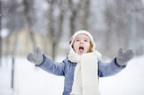 Little girl having fun at winter