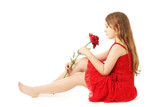 Pretty child girl with red rose