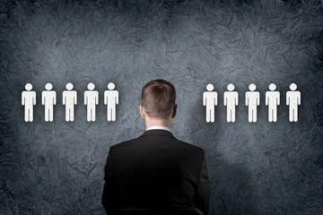 Businessman choosing between people