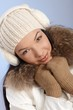 Attractive female in white cap and earmuffs