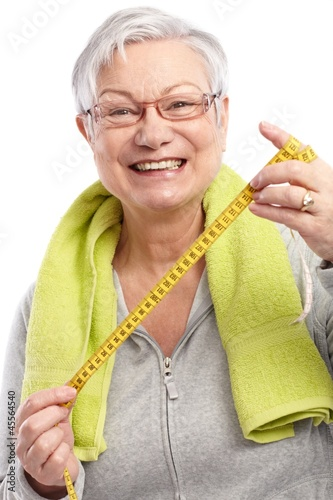 Happy old lady with tape measure