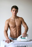 Young Sexy Man Ironing