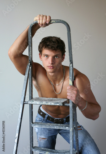 Young Muscular Man with a Stepladder