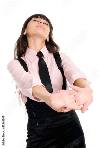 Young businesswoman demonstrating simple stretching exercise.
