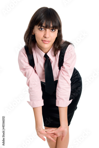 Young businesswoman demonstrating simple stretching