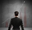businessman thinking on a ladder background