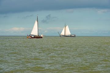 Sailing boat on a lake at fall