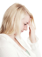 Young woman with extreme migraine headaches - isolated