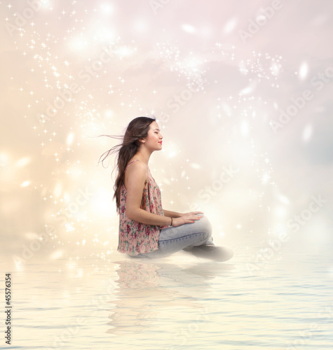 Happy Young Woman Sitting by the Water