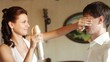 Bride nebulizes varnish on a groom