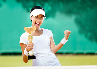 Pretty tennis player won the cup at the sport competition