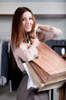 Woman carries paper bags and feels good after shopping