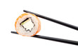 Sushi roll with black chopsticks, isolated on white