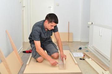 Man assembling a table.