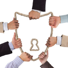 Business hands holding rope forming shield