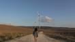 woman walking to wind energy