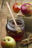 Honey and apples on wooden tabletop poster