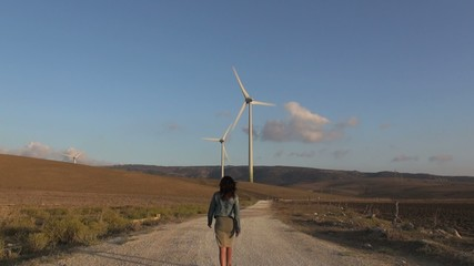 woman walking to wind energy