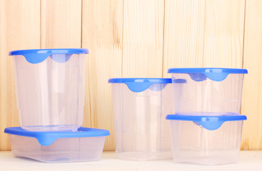 Plastic containers for food on wooden background