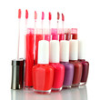 beautiful lip glosses and nail polish bottles, isolated on