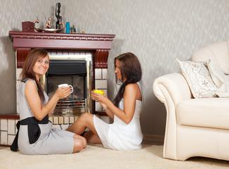 women near the fireplace
