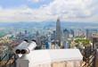 Binoculars and Kuala Lumpur (Malaysia) city view