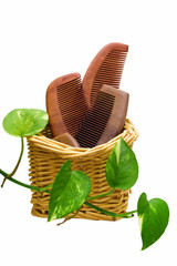 Wooden combs in the Rattan basket