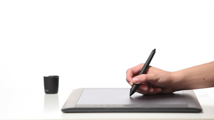 Person drawing on a computer tablet