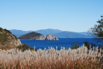 seascape with bright-blue sea and hills