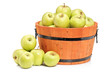 A studio shot of green apples in a wooden basket