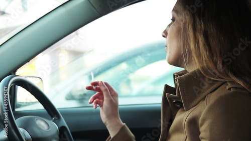 girl smoking in the car