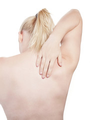 Young woman touching her back - isolated