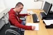 canvas print picture - Rollstuhlfahrer am Arbeitsplatz 2
