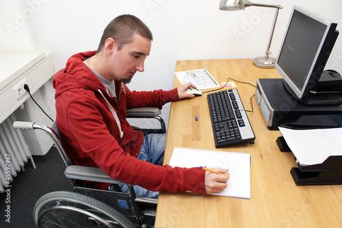 canvas print picture Rollstuhlfahrer am Arbeitsplatz 2