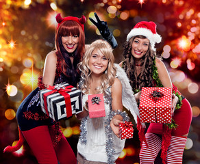 the unlike trio 01/Devil, Angel and Santa giving gifts